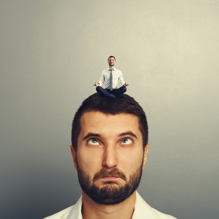 discredit: happy small man resting on the big head man