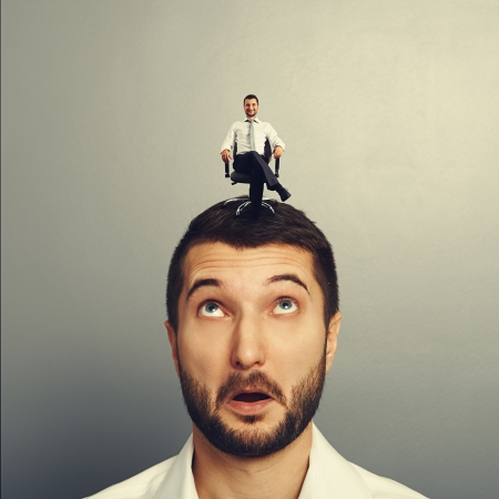 sponger: portrait of amazed man with happy successful man on the head