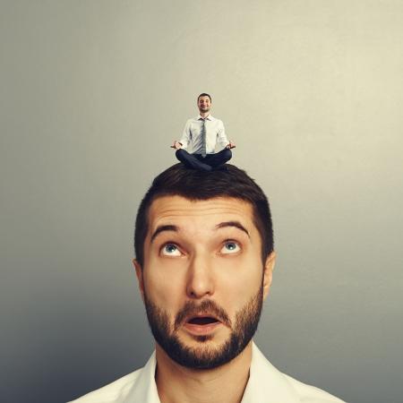 sponger: happy man relaxing on the big head amazed man
