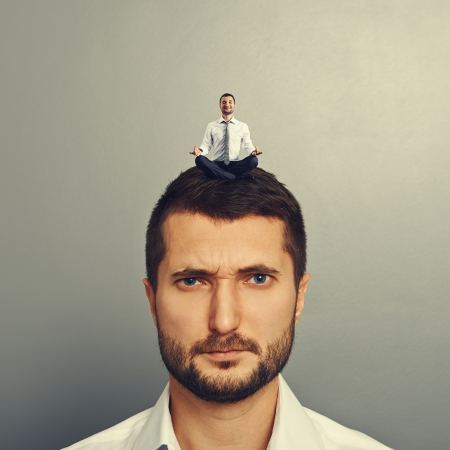 sponger: displeased man with small happy man on the head