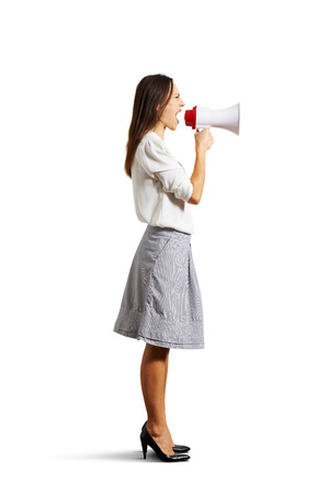 angry woman shouting at megaphone. isolated on white Stock Photo - 25201184