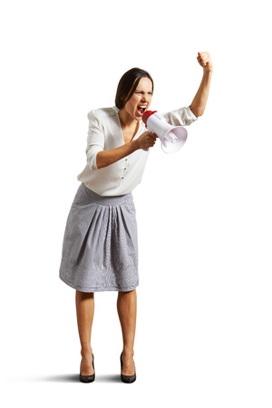 full-length portrait of screaming woman with megaphone. isolated on white  Stock Photo - 25201227