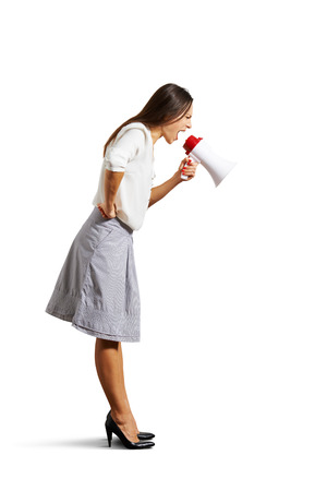 emotional angry woman looking down and shouting at megaphone Stock Photo - 25201235