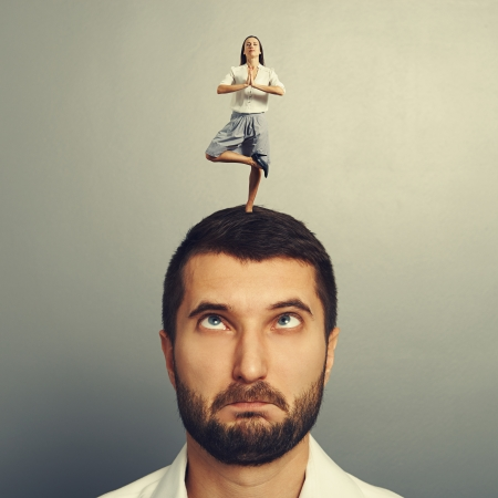 small meditation woman standing on the head of foolish man Stock Photo - 25579875