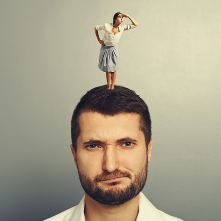 displeased man with small serious woman Stock Photo