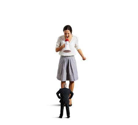 irritate: dissatisfied young businesswoman screaming at senior man. isolated on white background