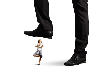 big boss put pressure on young businesswoman. isolated on white background photo
