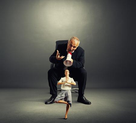 enraged: enraged boss screaming small female in dark empty room