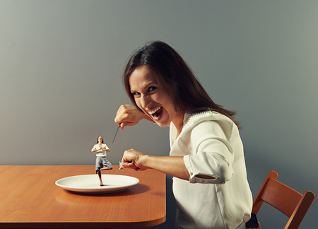 evil woman ready to eat small meditation woman photo