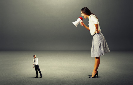 startled: scared man going away from angry woman