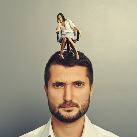 discontented: lazy woman sitting on the head of discontented man