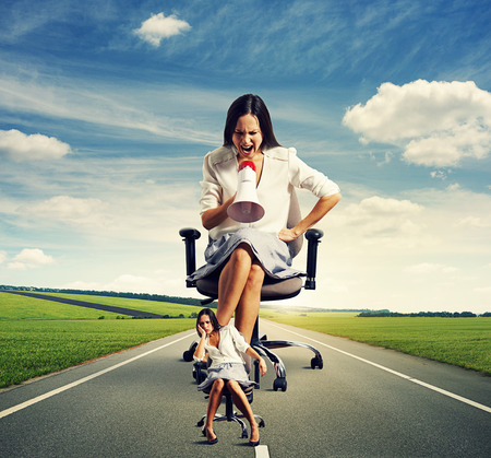 cheerless: dismal woman and emotional woman on the road Stock Photo