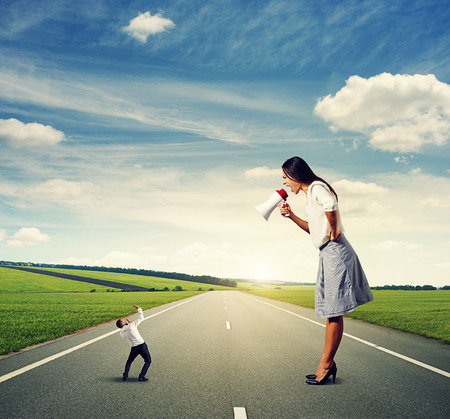 henpecked: scared man and angry woman on the road Stock Photo