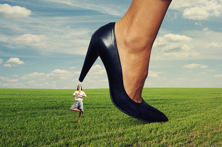 calm yoga businesswoman under big heel at outdoor photo