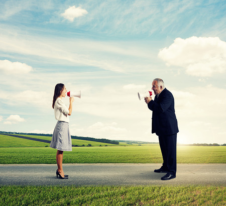 angry businessman screaming at mad businesswoman at outdoor photo