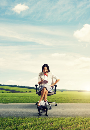 emotional big woman with megaphone and small lazy man on the road Stock Photo - 27075178