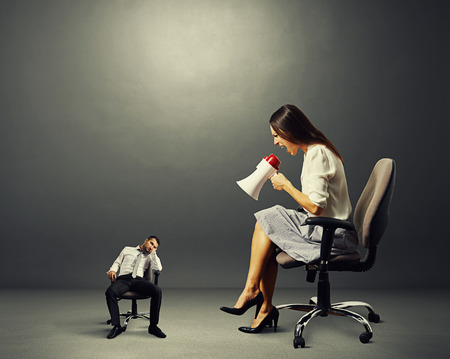 dismal: screaming businesswoman and tired small businessman over dark background