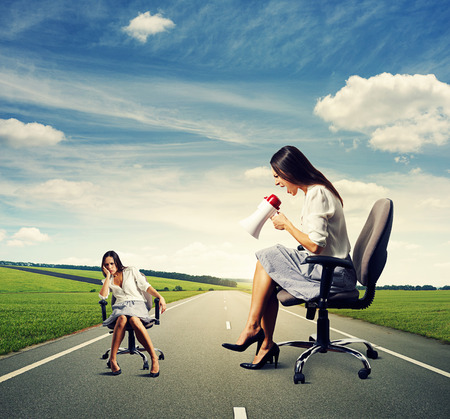 dismal: dismal woman and angry screaming woman on the road
