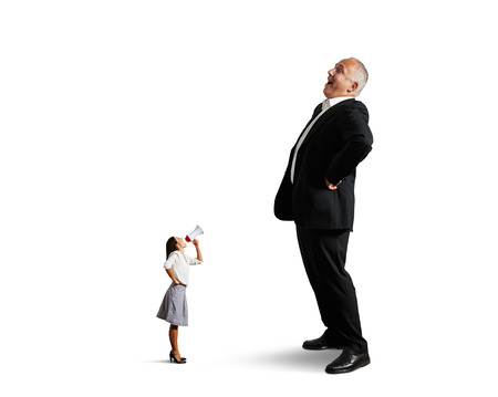 sneer: dissatisfied businesswoman screaming at big laughing businessman. isolated on white background