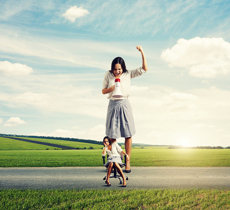 cheerless: dismal woman and angry screaming woman on the road at outdoor