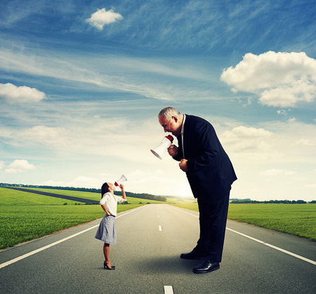 angry businesswoman and screaming man with megaphone on the road photo