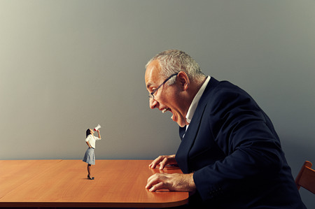 conflict between angry woman and dissatisfied senior man Stock Photo