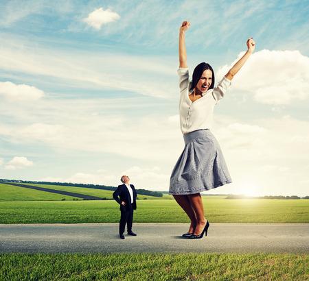 small businessman looking at big happy woman at outdoor photo