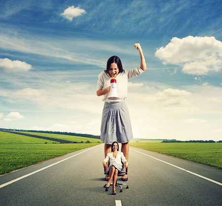 discontented: discontented woman and smiley woman on the road