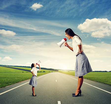 emotional two women with megaphone at outdoor photo