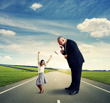 screaming businessman and joyful businesswoman on the road photo