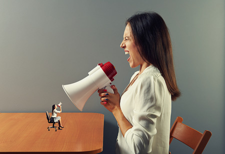 emotional screaming women with megaphone Stock Photo - 27696669