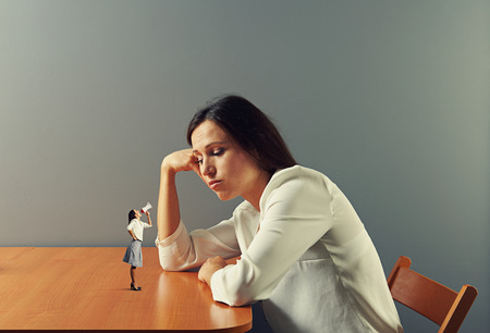 urging: small woman urging on tired businesswoman Stock Photo