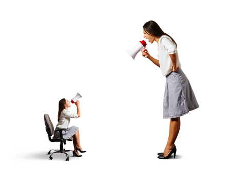 humiliation: two screaming women with megaphone. isolated on white background Stock Photo