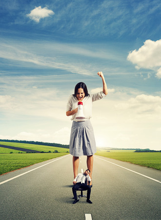 angry young woman and tired young man on the road Stock Photo - 27696703