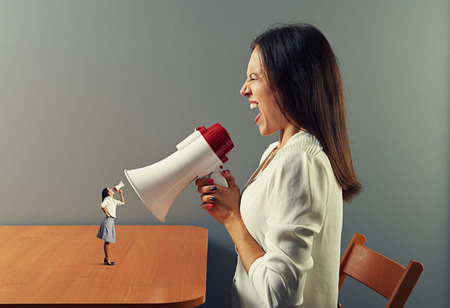 hysterics: emotional women with megaphone  Stock Photo