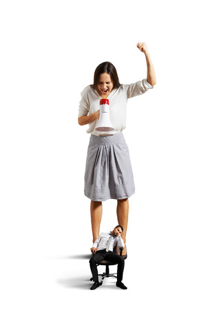 angry woman screaming at small lazy man over white background Stock Photo - 27696779