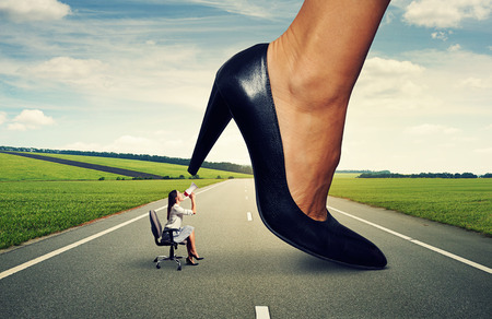 downtrodden: angry woman screaming at big lady boss on the road