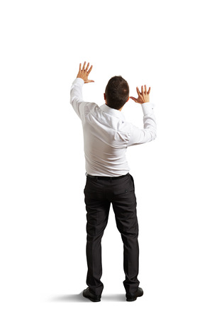 startled: back view of startled businessman looking up. isolated on white background Stock Photo