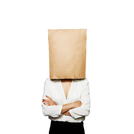 businesswoman hiding under paper bag. isolated on white background