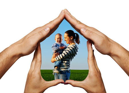 unmarried: happy mother with her smiley baby in the house from hands Stock Photo