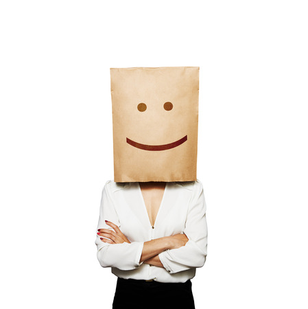 funny picture of businesswoman with paper bag on her head photo
