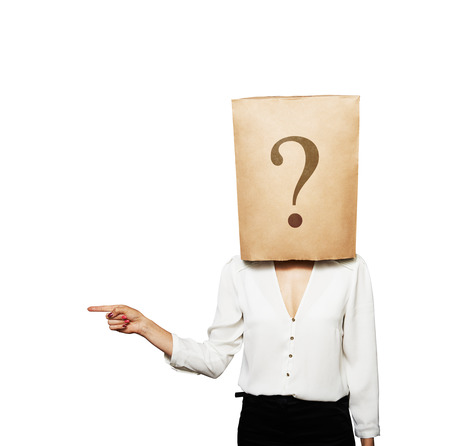 shopping questions: businesswoman with paper bag on the head pointing at something. isolated on white background