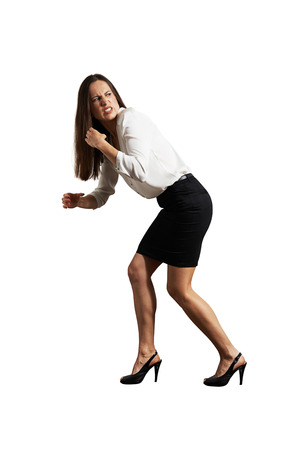 angry businesswoman pulling invisible rope. isolated on white background Stock Photo - 29018701