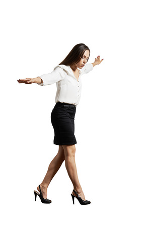 businesswoman walking on invisible line. isolated on white background Stock Photo - 29018702