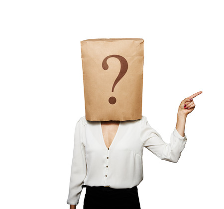 businesswoman with paper bag on the head pointing at something over white background photo