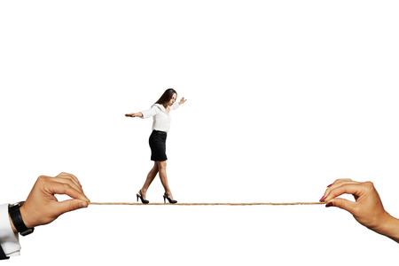 scared businesswoman balancing on the rope. isolated on white background Stock Photo