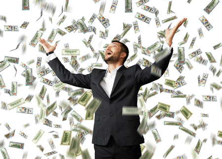 rain: happy excited businessman raising hands up and looking up under money rain