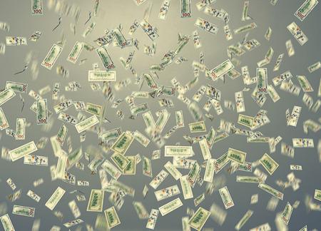 money rain: dollar note falling down over grey background