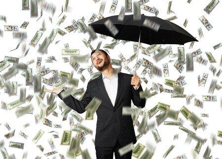 smiley glad businessman with umbrella standing under money rain and looking up Stock Photo - 29781922