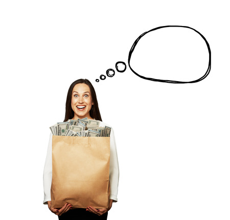 woman holding money: excited young woman holding paper bag with money over white background. concept photo with drawing speech bubble